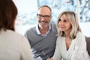 Couple working with wealth advisor
