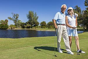 Elderly couple golfing talking about Social security planning