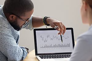 Employee showing investment data