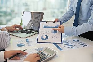 Employees doing in-depth analysis of investments of Risk Management