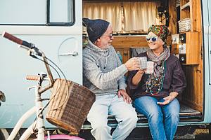 Happy elderly couple in van with Tax and retirement planning