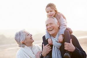 Happy grandparents that have Social security planning with grandchild