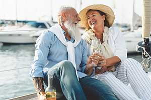 Happy retired couple with champagne
