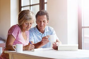 A couple making plans and setting goals for their retirement whiling having coffee