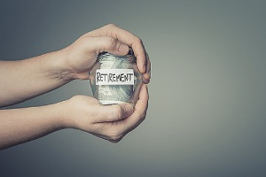 A man holding a glass jar full of US dollars. Financial planning is an effective strategy to better manage their money