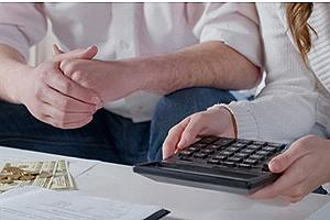 Couple reviewing current financial situation before a financial planning process