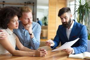 Couple reviews financial planning process with an advisor