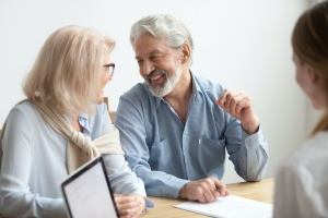 older couple meeting with consultant to know a women looking at Who Benefits From Financial Planning