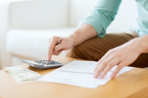 person using calculator to find out What Are The Objectives Of Financial Planning