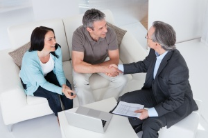 couple getting Financial planning tips from a advisor