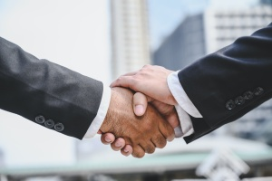 men shaking hands after knowing what Wealth Management vs. Financial Planning