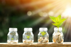 jars with money in them growing with a Retirement Planning Advisor In Fairfax VA
