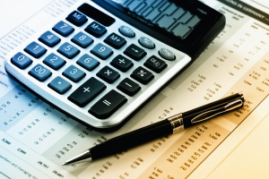 calculator finding cost for factors affecting financial planning