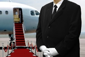 Man in black suits waiting next to private jet for Wealth Management Process