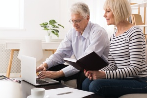 couple researching How To Choose A Wealth Management Firm at home
