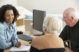 older couple meeting to find out What Do Wealth Management Firms Do