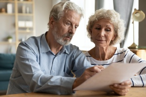 couple looking at a paper that explains What Do Wealth Management Firms Do