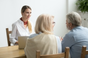 older couple working with a professional on how to choose a wealth manager