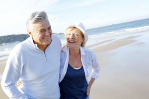 senior couple on beach since they had tax strategies for retirement