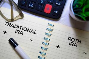 Traditional IRA and Roth IRA written on notebook